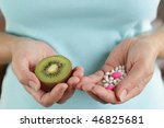 Mature woman and her choice -  pills or fruit - stock photo