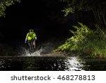 Mountain Biker At Night Riding...