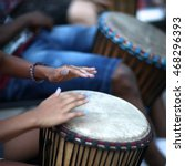 African Drummer Playing The...