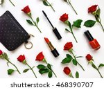 Stock photo colorful composition with red bright roses purse and woman accessories flat lay on white table 468390707