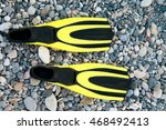 Yellow Flippers On The Beach