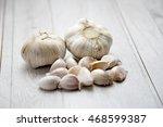 garlics on wood table | Shutterstock . vector #468599387