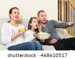 family of three watching movie... | Shutterstock . vector #468610517
