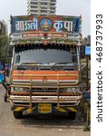 Small photo of MUMBAI, INDIA - OCTOBER 10, 2015: Colorful bus on the street of Mumbai, India. With 12 million people, Mumbai is the most populous city in India and the 9th most populous agglomeration in the world.