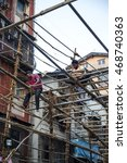 Small photo of MUMBAI, INDIA - OCTOBER 9, 2015: Unidentified people working street of Mumbai. With 12 million people, Mumbai is the most populous city in India and the 9th most populous agglomeration in the world.