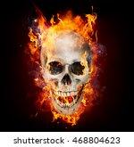 satanic skull in flames in the...