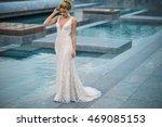 beautiful bride outdoors on a... | Shutterstock . vector #469085153