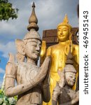 Small photo of Brahma angel statue made of carved wood and blue sky. Can see in the Thailand temple