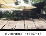 empty wood table top with blur... | Shutterstock . vector #469467467