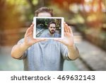 attractive young man taking a... | Shutterstock . vector #469632143