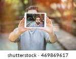 handsome young man making a... | Shutterstock . vector #469869617