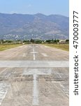 Small photo of Runway of Castellon de la Plana's airfield, without planes, near the beach. At background, the -Desert of the Palms- mountains.