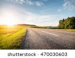 Empty Country Road At Sunrise