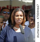 Small photo of NEW YORK CITY - AUGUST 15 2016: The Muslim community held a memorial service for slain Imam Maulano Akojee & Thara Uddin in East New York & a march to Ozone Park, Queens. Public advocate Letitia James