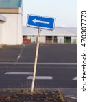 Small photo of Traffic sign arrow pointing left, sign on an abandoned Amarican Airforce base on Iceland