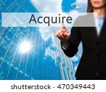 Small photo of Acquire - Isolated female hand touching or pointing to button. Business and future technology concept. Stock Photo