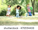 cute kids with books in park | Shutterstock . vector #470554433