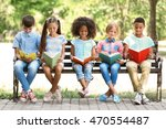 cute kids reading books on bench | Shutterstock . vector #470554487