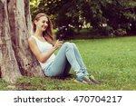 young woman sitting on the... | Shutterstock . vector #470704217