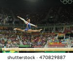 Small photo of RIO DE JANEIRO, BRAZIL - AUGUST 11, 2016: Olympic champion Simone Biles of United States competing on the balance beam at women's all-around gymnastics at Rio 2016 Olympic Games