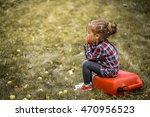 little girl sitting on a red... | Shutterstock . vector #470956523