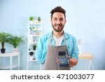 happy man holding bank terminal ... | Shutterstock . vector #471003077