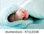 two cute tiny baby feet wrapped ... | Shutterstock . vector #47113108