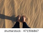A Foot Of Girl On White Sand...