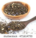 Small photo of Dried black Earl Grey loose tea leaves over white background