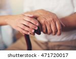 young woman holding hand of old ... | Shutterstock . vector #471720017