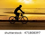 man cycling at beach on... | Shutterstock . vector #471808397