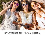 Three Cute Hippie Girl Lying O...