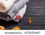 cozy sweaters and autumn leaves ... | Shutterstock . vector #472055467