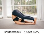 young woman doing yoga... | Shutterstock . vector #472257697
