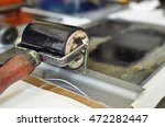 an ink roll covered with black... | Shutterstock . vector #472282447
