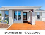 front of a modern home with... | Shutterstock . vector #472326997
