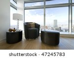 Small photo of Modern leather armchair with taboret and side table with stylish lamp