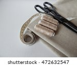 thread on linen fabric scissors  | Shutterstock . vector #472632547