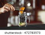 woman hands putting fruits into ... | Shutterstock . vector #472783573