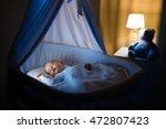 adorable baby sleeping in blue... | Shutterstock . vector #472807423