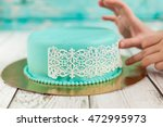 preparing elegant wedding cake... | Shutterstock . vector #472995973