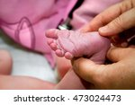 the hands of a midwife test the ...   Shutterstock . vector #473024473