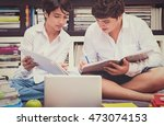 two schoolboys in the library ... | Shutterstock . vector #473074153