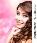 attractive smiling woman | Shutterstock . vector #473408317