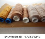 spools brown thread on fabric  | Shutterstock . vector #473634343