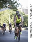 Small photo of NEW YORK - JUL 24 2016: Achilles International ParaTriathletes compete in the Panasonic NYC Triathlon, biking 40 kilometers mainly on the Henry Hudson Parkway.