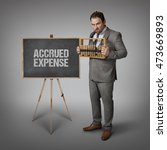 Small photo of Accrued Expense text on blackboard with businessman