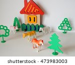 wooden house and plastic trees... | Shutterstock . vector #473983003