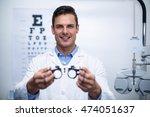 portrait of smiling optometrist ... | Shutterstock . vector #474051637