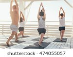 group of people practicing yoga ... | Shutterstock . vector #474055057